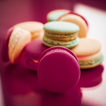 French macaroons on cherry pink background, parisian chic cafe d