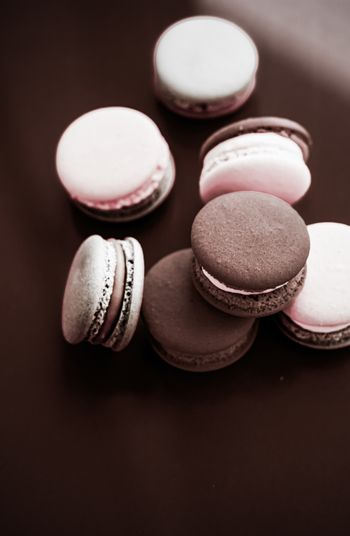 French macaroons on milk chocolate background, parisian chic caf