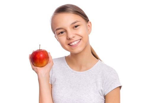 Happy beautiful young teen girl holds apple, isolated on white background