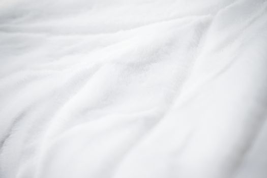 Luxury white fur coat texture background, artificial fabric deta