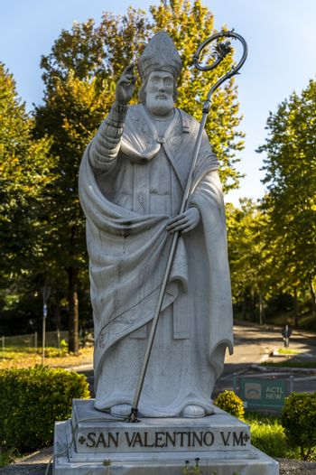 statue of San Valentoino placed at the roundabout of street filippo turati in terni