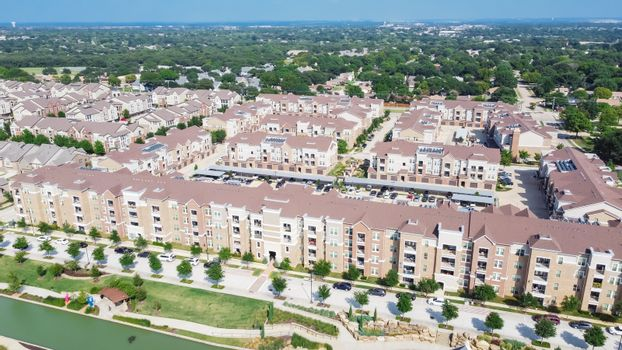 Flyover multistory apartment complex and suburban residential area in Flower Mound, Texas, US