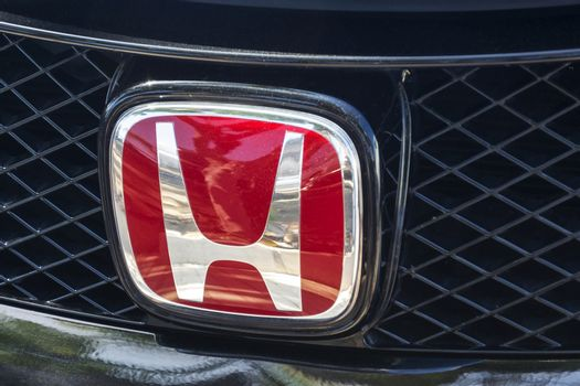 HONDA company logo on the grille of the car