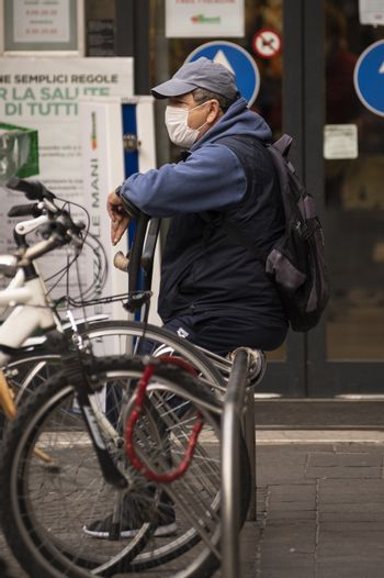terni,italy october 23 2020:man sitting with medical mask leaning on a crutch