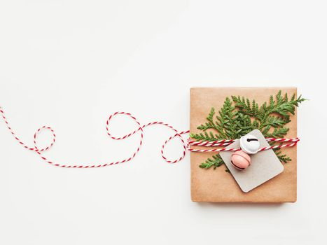 Christmas DIY presents wrapped in craft paper with fir tree branches and red hearts. Top view on decorations on New Year gifts. Festive background. Winter holiday spirit. Banner with copy space.