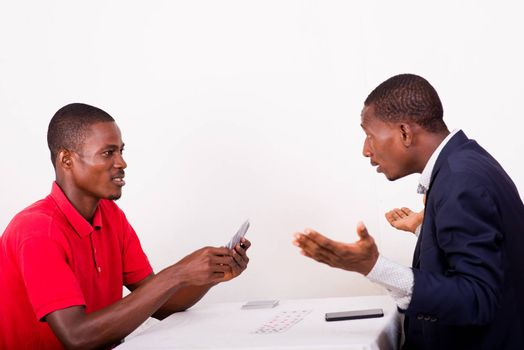 Young men playing cards at the game table, Young people having funny concept and disappointed to have lost to the card game.