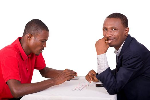 Young men playing cards at the gaming table, man in suit having funny concept and happy to have won at the card game.