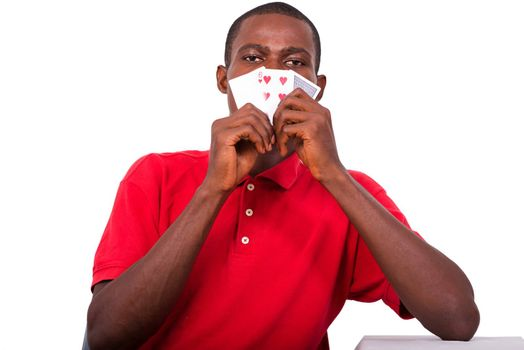 man holding playing cards sticking to face