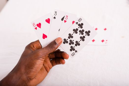 Cards in hand, luck or risk in money or in love. game concept
