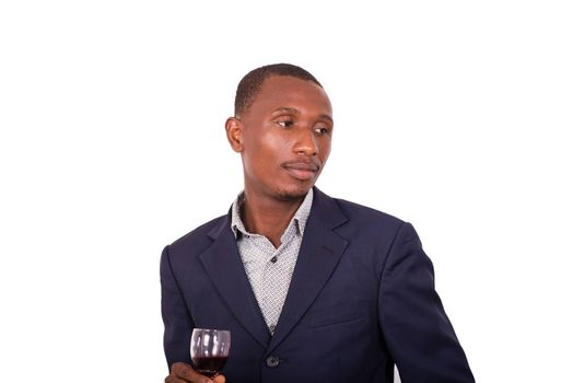 portrait of young businessman holding a glass of red wine isolated on white background.