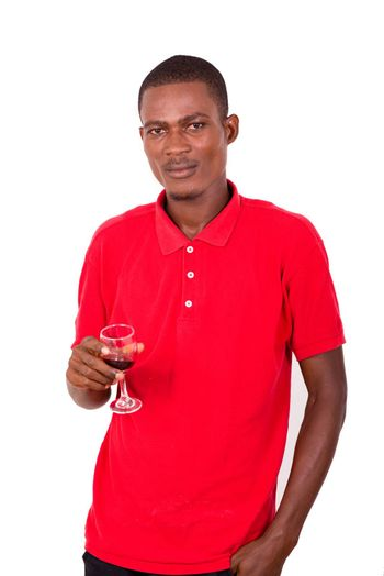 portrait of young man holding a glass of red wine isolated on white background.