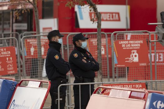 Police and state security forces and bodies, guarding the finish area of the fourth stage of La Vuelta a España 2020.