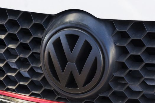 Company logo VW on the grille of the car