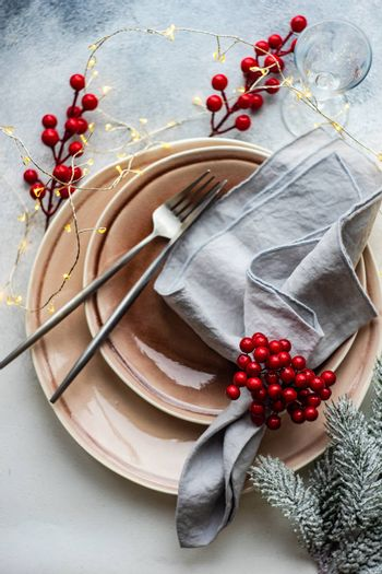 Festive place setting for celebration the Christmas eve on concrete table