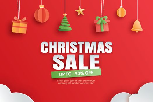 Christmas sale with gifts and elements hanging on red background