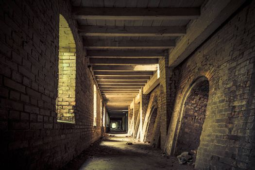Urban exploring in an old abandoned brick factory, a lost place with ancient history, vandalism and graffiti
