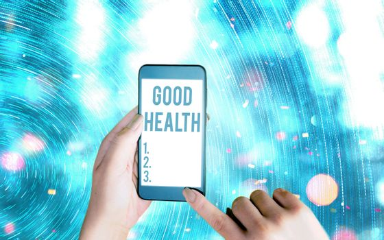 Handwriting text writing Good Health. Concept meaning state of being vigorous and free from a bodily or mental disease Modern gadgets with white display screen under colorful bokeh background.