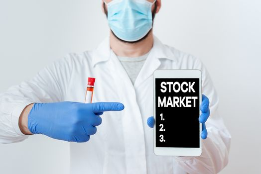 Writing note showing Stock Market. Business photo showcasing Particular market where stocks and bonds are traded or exhange Laboratory Blood Test Sample Shown For Medical Diagnostic.