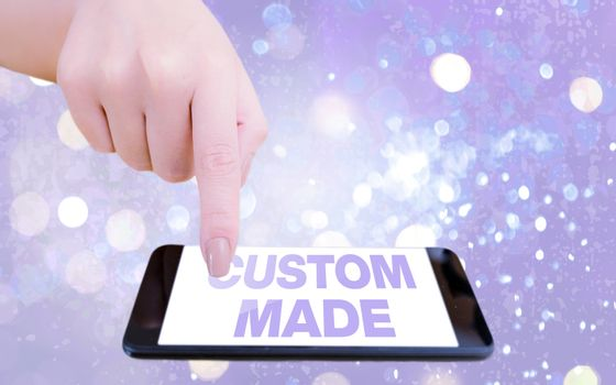 Text sign showing Custom Made. Conceptual photo something is done to order for particular customer organization Modern gadgets with white display screen under colorful bokeh background.