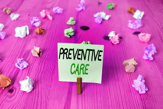 Word writing text Preventive Care. Business concept for the care you receive to prevent illnesses or diseases Colored crumpled rectangle shaped reminder paper light blue background.