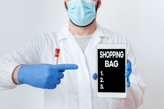 Writing note showing Shopping Bag. Business photo showcasing Containers for carrying an individualal possessions or purchases Laboratory Blood Test Sample Shown For Medical Diagnostic.