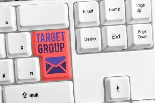 Handwriting text Target Group. Concept meaning Particular showing that an advertisement intended to reach to Different colored keyboard key with accessories arranged on empty copy space.