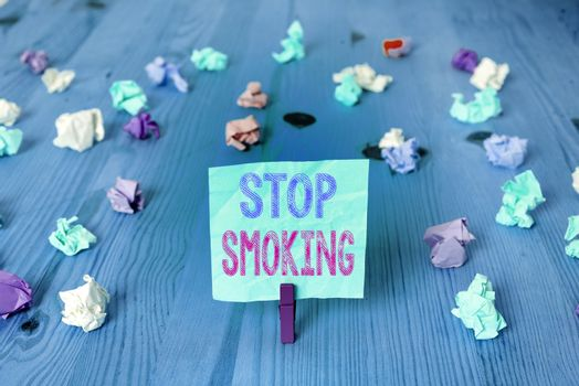 Writing note showing Stop Smoking. Business photo showcasing Discontinuing or stopping the use of tobacco addiction Colored crumpled rectangle shaped reminder paper light blue background.