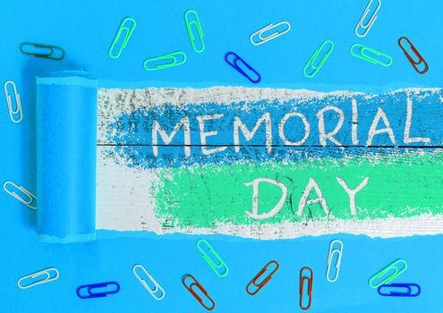 Text sign showing Memorial Day. Conceptual photo To honor and remembering those who died in military service Rolled ripped torn cardboard placed above a wooden classic table backdrop.