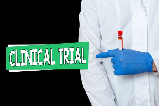 Writing note showing Clinical Trial. Business photo showcasing evaluate the effectiveness and safety of medications Displaying Sticker Paper Accessories With Medical Gloves On.