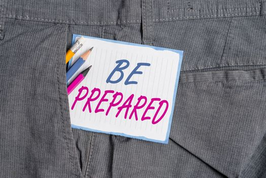 Handwriting text Be Prepared. Concept meaning make something ready for use or consideration at future Writing equipment and white note paper inside pocket of man work trousers.
