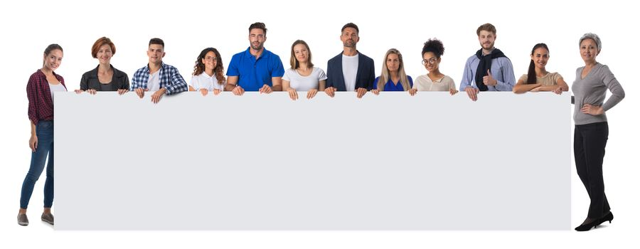 Group of hapy people standing together and holding a blank sign for your text, isolated on white background