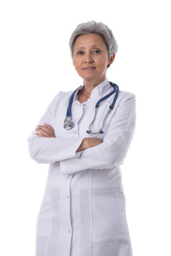 Asian mature female medical doctor with stethoscope isolated on white background, crossed arms gesture
