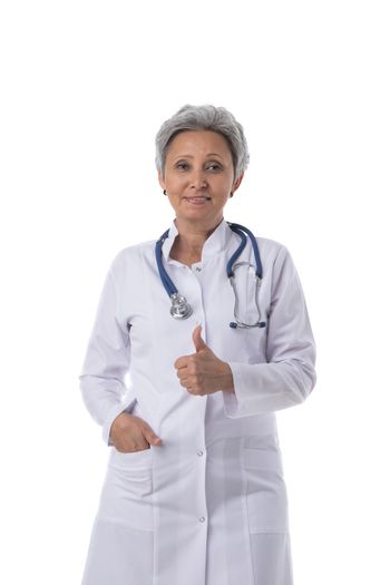 Asian mature female medical doctor with stethoscope isolated on white background, thumb up gesture