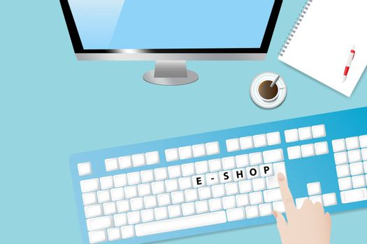 Top view of the office desk with coffee cup, blank paper with pen, computer monitor and keyboard. Hand is touching keyboard with inscription E-shopping