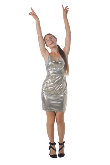 Full length portrait of young party dancing girl in silver dress isolated over white background
