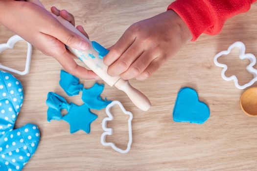 Children's hands and simulation cooking toys in the kitchen counter