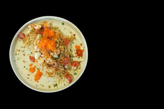 fusion food style , Cream sauce spaghetti egg shrimp on black background