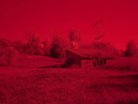 infrared photo of an old barn in a landscape in Germany