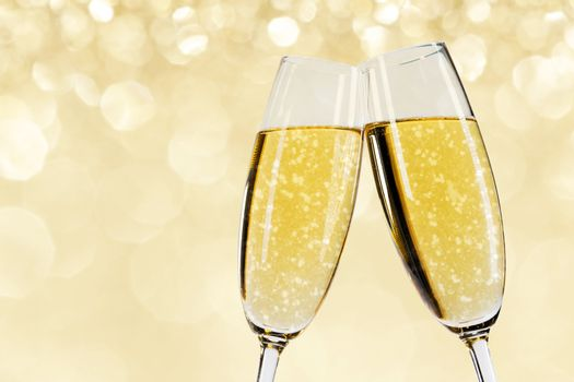 Two glasses of champagne with bokeh lights in the background New Year party celebration concept