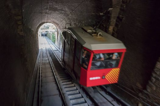 Upper city funicular line in Bergamo (Funicolare Citta Alta). Red funicular connects old Upper City and new. Bergamo (upper town), ITALY - August 19, 2020.