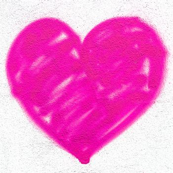 Pink heart on grungy wall. Creative spray paint. Ideal for Love and Valentine's Day concepts.