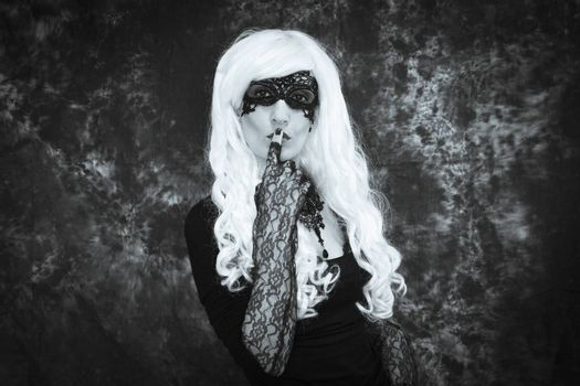 Woman disguised in gothic style for halloween party with mask