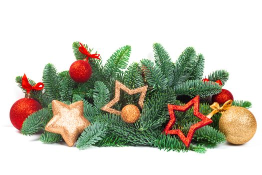 Christmas evergreen spruce noble fir tree and red golden glitter glass bauble balls and stars isolated on white background