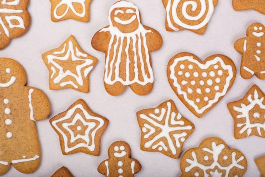 Gingerbread men stars and snowflakes glazed cookies Christmas background