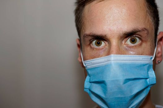 Close up of a man in a medical protective mask