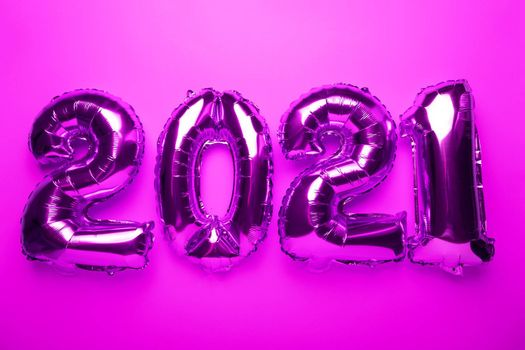 2021 concept new year from purple pink foil balloon stock photo