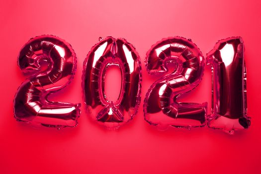 2021 concept new year from red foil balloon numbers on red background