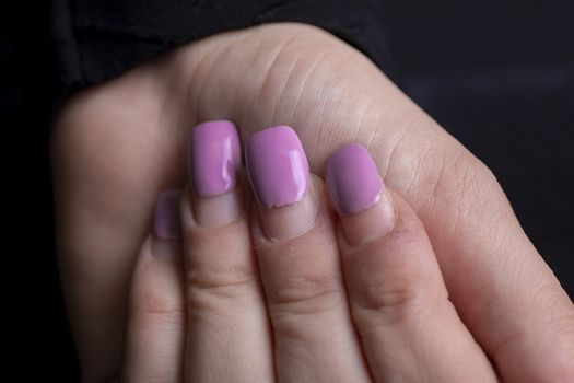 Overgrown manicure. Female hands with overgrown nails. Time for correction gel polish. nail care concept stock photo