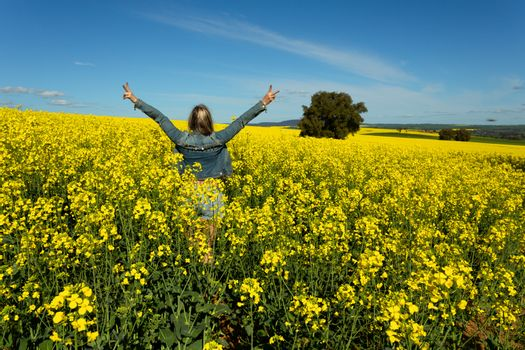 Excuted farm girl in bumper crop of canola