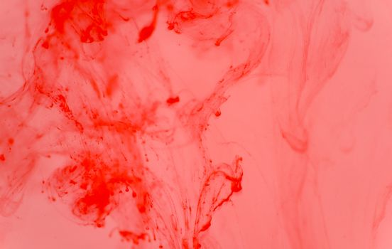 Color ink broken from dripping into water, abstract concept, background image.